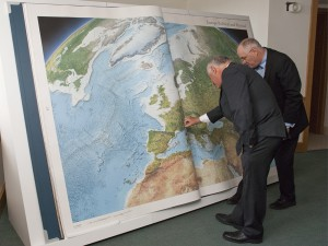 British Library. Peter Barber (Head of Maps) and Gordon Cheers (Millennium House Publishing) inspect  the Earth Platinum Atlas.